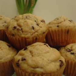 Banana Chip Muffins I Recipe - Light like a cupcake, these banana babies are flecked with chocolate chips for a terrific flavor combination.