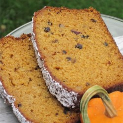 Pumpkin Tea Bread Recipe - Orange juice and zest lend a delightfully citrus accent to this mildly spiced pumpkin-nut-date bread.