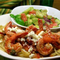 Fire Roasted Tomato and Feta Pasta with Shrimp Recipe - Linguine pasta and sauteed shrimp are bathed in a basil-flavored fire roasted tomato sauce and sprinkled with feta cheese.