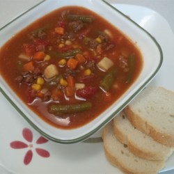 Awesome Beef Vegetable Soup Recipe - This hearty beef vegetable soup is made with ground beef and is packed full of delicious veggies and seasonings.
