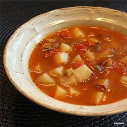 Spicy Potato Soup I Recipe - In this simple vegetarian soup, fried potatoes are simmered in a broth with paprika, chopped red bell peppers and Serrano chilies.