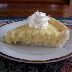 Coconut Cream Pie IX Recipe - Flaked coconut is folded into a homemade custard in this classic pie.