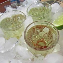 Kamikaze Shots for a Crowd Recipe - Make this crowd-pleasing basic kamikaze shooter recipe with vodka, lime, and triple sec, when you are entertaining a group!