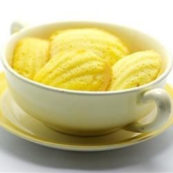 Lemon Madeleines Recipe - Delicate Madeleine cookies are flavored with lemon juice and zest and are perfect for your afternoon tea.