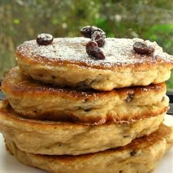 Apple Raisin Cakes Recipe - Cakes made with applesauce and raisins and spiced with cinnamon, vanilla and a hint of sugar are quickly fried for a hot snack.