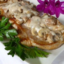 Mushroom Pork Chops Recipe - Transform cream of mushroom soup into a delicious simmering sauce by tossing in some chopped onion and sliced fresh mushrooms. Add to seasoned and sauteed pork chops and you have a rich and creamy meal.