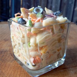 Mom's Best Macaroni Salad Recipe and Video - This is, by far, the best macaroni salad I've ever put into my mouth. It has a perfect blend of sweetness and tartness, and it is so pretty with all of the multi-colored veggies. Be ready for this to disappear before you put it on the table! I have six children, and it is all I can do to keep them from nibbling on it while I'm mixing it up!