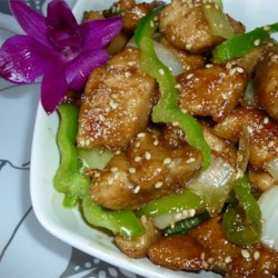 Amber's Sesame Chicken Recipe - Honey, teriyaki sauce, Chinese five-spice powder, and red pepper flakes give distinctive flavor to this quick, homemade version of the classic Chinese dish.