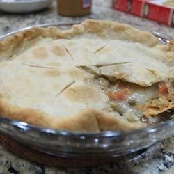 Easy Vegetable Pot Pie Recipe and Video - Pull what you need from the freezer or pantry from this one. Frozen pie crust, a can of cream of potato soup, and a mega can of mixed veggies. An egg, some milk and a dash of thyme, and you have the fixings for a wonderful pie that your family will think