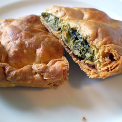 Spanakopita Recipe - Spinach combined with feta, Swiss and Parmesan cheeses and baked between layers of phyllo dough.  A treat that's worth the time it takes to prepare!