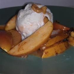 Sweet Baked Apples Recipe - Red apple slices baked in a caramel sauce with a hint of spice.