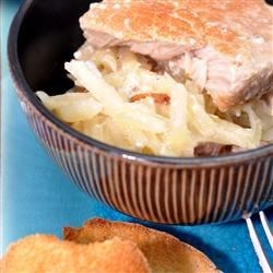 Shirred Potatoes and Pork Chops Recipe - Pork chops and shredded potatoes, topped with a homemade white sauce, bake slowly in the oven to make a comfort-food casserole for a winter's night. You can add cheese, onion, or just about anything to make this recipe your own.