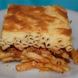 Pastitsio Recipe - Pastitsio is a layered Greek casserole of macaroni and seasoned ground lamb, topped with a thick cream sauce.  This version substitutes beef in place of the lamb to suit American tastes.