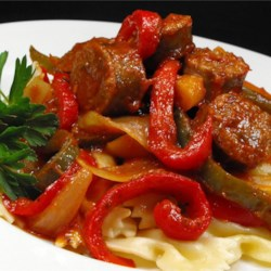 Easy Sausage, Peppers and Onions with Elbows Recipe - Sweet and hot Italian sausages are cooked in a slow cooker with red and green bell peppers and sweet onions. Serve over pasta, and you have an easy weeknight meal.