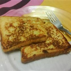 Pain Perdu II Recipe - Pain Perdu is a special New Orleans-style French Toast. The most tender version is made with wide loaves of French or Italian bread. Its great flavor comes from the orange brandy in the batter.
