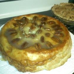Upside Down Caramel Apple Pie Recipe - Apple pie is baked over a layer of caramel pecan, then the pie is inverted to present the caramel on the top.