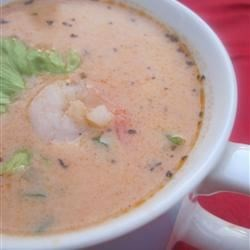 Shrimp Bisque II Recipe - Shrimp shells and spices are simmered in thickened seafood stock seasoned with paprika and tomato paste, then combined with shrimp, cream and sherry in this classic bisque.