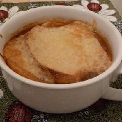 Creole Onion Soup Recipe - Onions are cooked with spaghetti sauce and beef broth, seasoned with Creole seasoning and served with bread and cheese in this tasty onion soup.