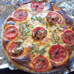 Tomato Pie I Recipe - Savory and robust, this pie is packed with textures and flavors. Tomatoes, fresh basil, scallions, crumbled bacon and spices, are layered in a deep-dish pastry shell and covered with grated cheese and mayonnaise. The pie is baked for an hour and served warm or cold.