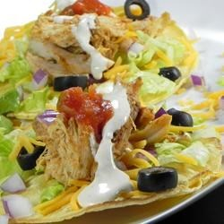 Ranch Chicken Tacos Recipe - Turn leftover rotisserie chicken into kid-friendly ranch chicken tacos. Corn tortillas are filled with shredded chicken, your favorite taco fixings, and a creamy sour cream ranch dressing.