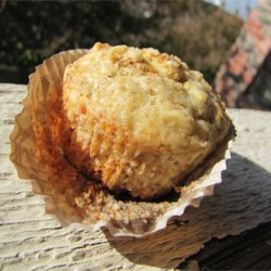 Banana Nut Muffins Recipe - Sometimes less means more, as with these muffins made with egg whites, a little oil and a scattering of chopped walnuts.  The lemon zest makes for a delicate contrast to the sweet banana batter.