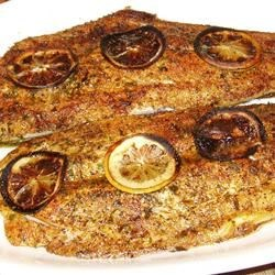 Broiled Spanish Mackerel Recipe - This simple recipe for fish cooked under the broiler uses lemon slices, paprika, salt, and pepper to season fresh Spanish mackerel.