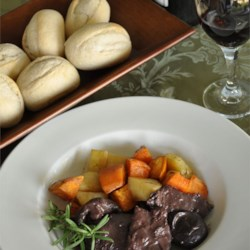 Braised Venison with Rosemary and Shiitake Recipe - Venison is simmered in red wine with shiitake mushrooms and cognac in this savory and sophisticated dish I created to please my hunter.  I like to serve this with spaetzle, merlot, and salad.
