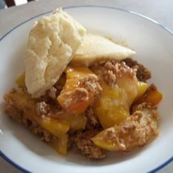 Peach Crisp III Recipe and Video - Very easy dessert with wholesome granola and oats for the topping. Not too sweet for those who prefer natural peach flavors. Good peaches make the difference, but you can use canned. Serve warm with fresh whipped cream.
