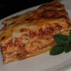 Kristy's Lasagna Recipe - A meaty tomato sauce flavored with garlic salt and Italian seasonings is spooned over layers of noodles and cheeses in this easy-to-make lasagna. Top with mozzarella cheese and bake until browned and bubbly.