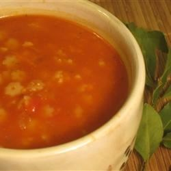 Sitta Soup Recipe - Noodles fried in olive oil are boiled in chicken broth with a puree of garlic, onion and tomato sauce in this comforting soup which is delicious served with a sprinkling of grated parmesan cheese.