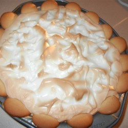 Banana Cream Pie V Recipe - Delicious vanilla pudding is made from scratch on the stove top, then layered in a deep dish pie shell with banana slices. The pie is then covered with meringue and toasted in the oven.