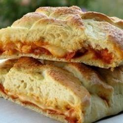 Calzone Recipe and Video - Calzone dough for the bread machine gets rolled out and stuffed with pizza sauce, sausage and cheese. Or stuff it with whatever you like.