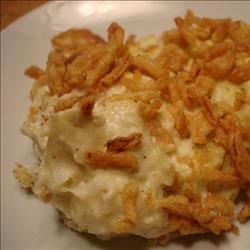 Philly Mashed Potatoes Recipe - Mashed potatoes combined with cream cheese, onion, eggs and flour, and topped with French-fried onions.  A great way to use left over mashed potatoes!