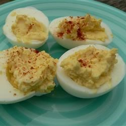 April's Deviled Eggs Recipe - Slices of egg, filled with delicately spiced creamy goodness. Served cool.