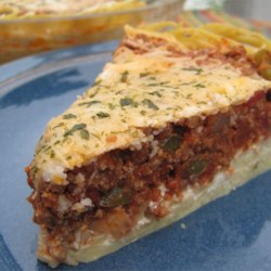 Spaghetti Pie I Recipe - Buttered Parmesan pasta, homemade meat sauce, cottage cheese, and mozzarella are layered into this delicious baked spaghetti casserole.