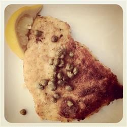 Terry's Lemon Caper Chicken Recipe - Pan-fried chicken breasts are cooked golden brown, and served with capers and lemon wedges for a quick but light and elegant main dish.