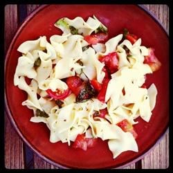 Tomato Basil Tagliatelle Recipe - This simple, fresh pasta dish makes a great light lunch or supper, especially when the freshest tomatoes and herbs are in season. Just toss hot cooked pasta in a light vinegar and oil dressing with the tomatoes, and serve with freshly shredded Parmesan.