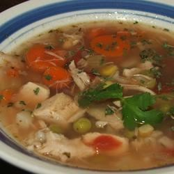 Turkey Carcass Soup Recipe - Get every last bit of turkey goodness from your turkey by making broth from the carcass and simmering it into a hearty soup with lots of delicious vegetables and barley.