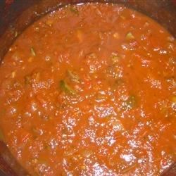 Fresh Spaghetti Sauce Recipe - Fresh roma tomatoes are gently simmered with zucchini, green and red bell pepper, mushrooms and herbs for a savory meatless spaghetti sauce.  The addition of ricotta cheese, just before serving, makes the sauce nice and rich.