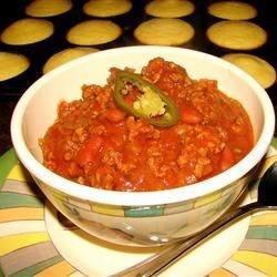 Quick and Spicy Chili Recipe - Packed with beef and spice, this chili is sure to please. Also works with ground turkey, or the meat may be omitted.