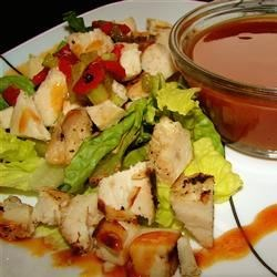 BBQ Chicken Salad Recipe - This lively salad of grilled chicken, corn, bell pepper, and onion is dressed with a tangy mixture of barbeque sauce and mayonnaise.