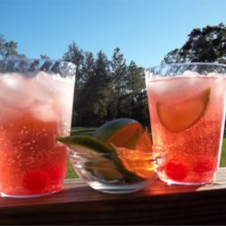 Cherry Bomb Recipe - This is a wonderful rum drink with lime and grenadine. It's great for any occasion. If this recipe seems too easy, well it is, but the drink is incredibly enjoyable and worth the lack of trouble!
