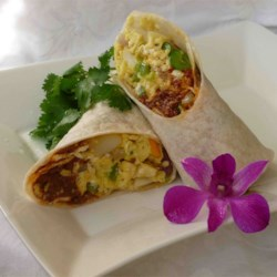 Chorizo Breakfast Burritos Recipe - A yummy breakfast burrito of cooked, crumbled chorizo sausage with onions and scrambled eggs mixed throughout. Serve on warm flour tortillas with a generous helping of shredded Cheddar cheese for the perfect hangover cure!