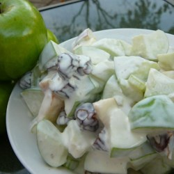 Triple Crunch Apple Salad Recipe -  The crunch part consists of crisp apples, celery and toasted hazelnuts, but there are also dates and orange juice in this wonderful salad. And the dressing is heavenly  - sour cream, mayonnaise and whipped topping. Chill and serve to four.