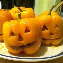 Stuffed Jack-O-Lantern Bell Peppers Recipe - Cut faces into stuffed peppers to make cute jack-o'-lanterns for your Halloween dinner. Use yellow or orange peppers for an even more realistic effect. The flavorful beef stuffing is made with whole wheat bread instead of rice.