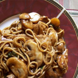 Chicken Lo Mein Recipe - A chicken and mushroom stir fry with pungent ginger, sesame and soy overtones, served atop soft noodles.