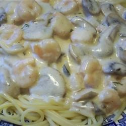 Shrimp Alfredo Pasta Recipe - Creamy Alfredo sauce with lots of flavorful shrimp, angel hair pasta and spices.