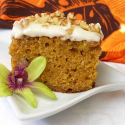 Pumpkin Sheet Cake Recipe - Pumpkin sheet cake with cream cheese frosting, sprinkled with nuts.  Cut into bite-sized pieces, it's perfect for your next potluck!