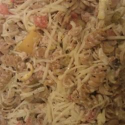 Tuna Casserole II Recipe - This fried onion-topped tuna casserole is great for a quick meal. Red and green bell peppers, carrots, and zucchini give it color, and it's topped with mozzarella or Cheddar cheese.