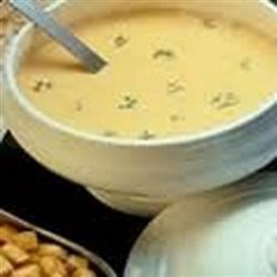 Swiss Cheese Soup Recipe - This garlicky veloute soup contains chicken broth and white wine thickened with a roux.  A generous amount of grated Swiss cheese is melted into the flavorful broth immediately prior to serving.